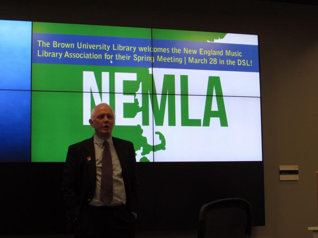 Ned Quist in front of NEMLA screen